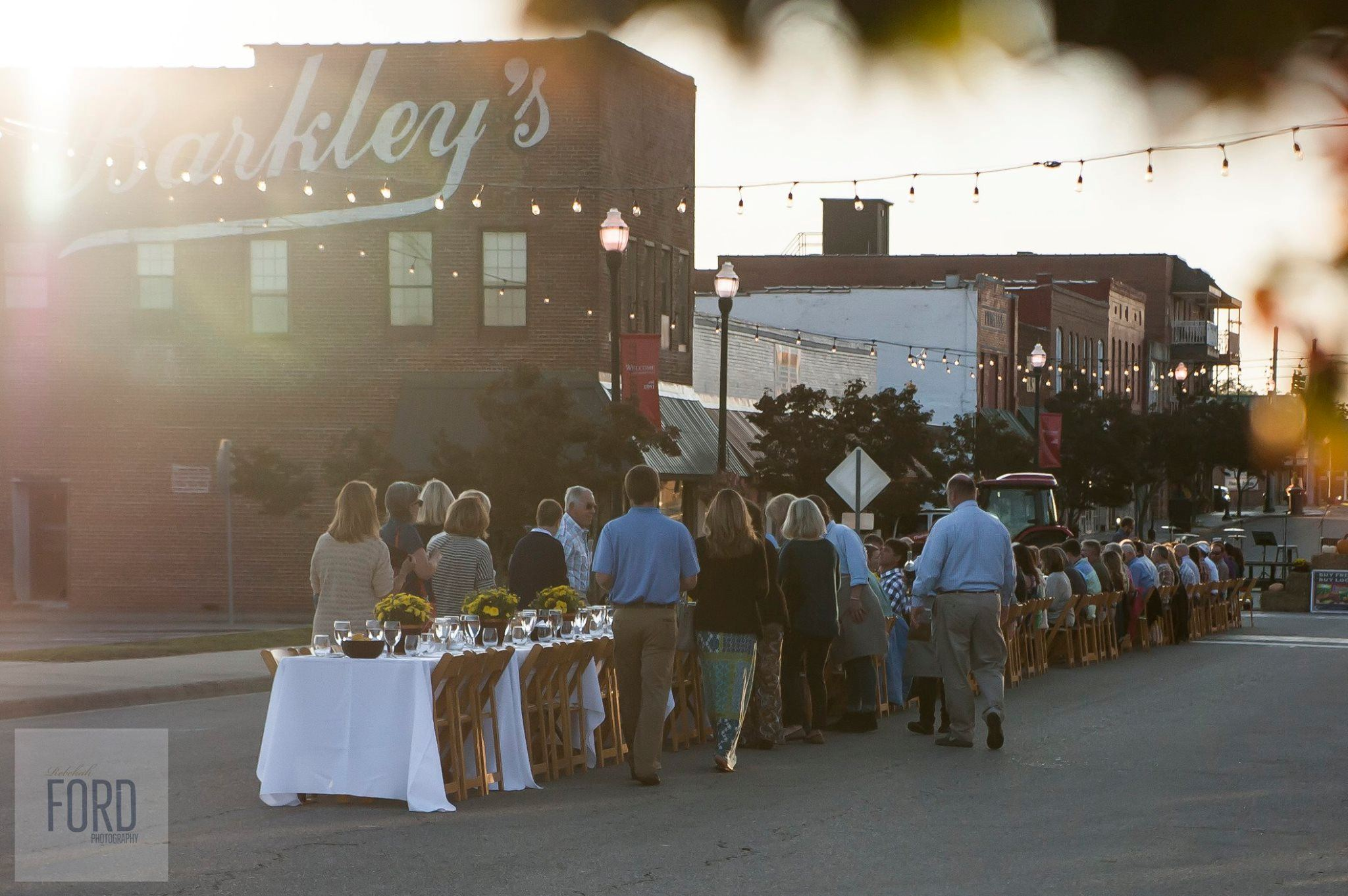 Photo of community dining outside on Main Street in downtown Albertville at Farmers Market event
